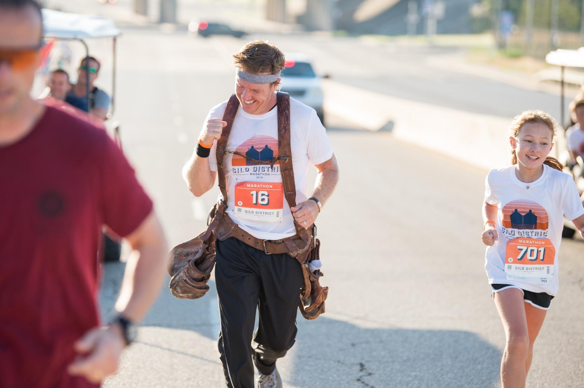 Silo-District-Marathon-Chip-Gaines-Running-With-Daughter-Toolbelt-Waco